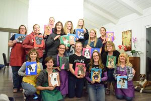 people holding paintings of their pets thorn beer
