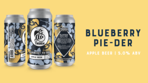 three cans of blueberry pie-der apple beer on a yellow background