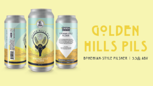 three cans of golden hills pilsner on a yellow background