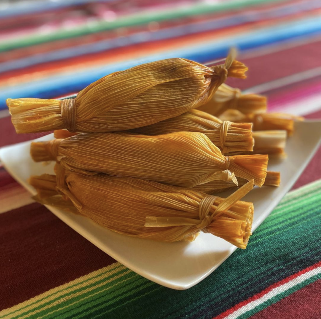 tamales on a plate on a blanket